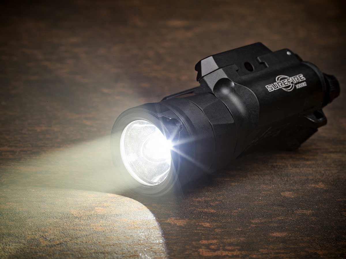 Pistol Light on a wooden table with an LED beam