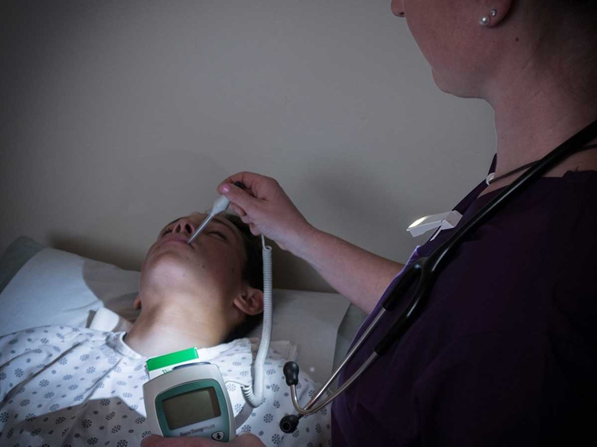 QuiqLite MED clip-on light in action with doctor and patient