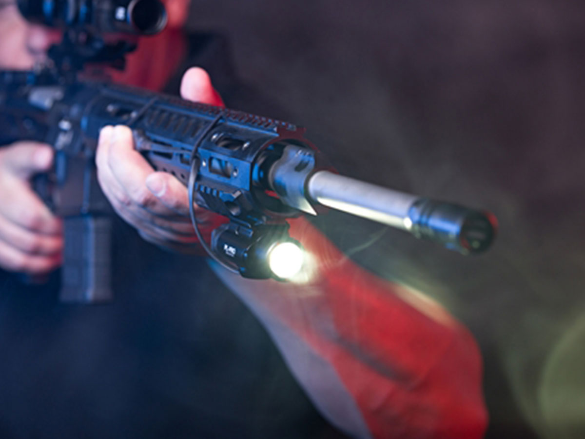 OLIGHT RPL 7 IN USE ON A WEAPON WITH A LIGHT IN USE