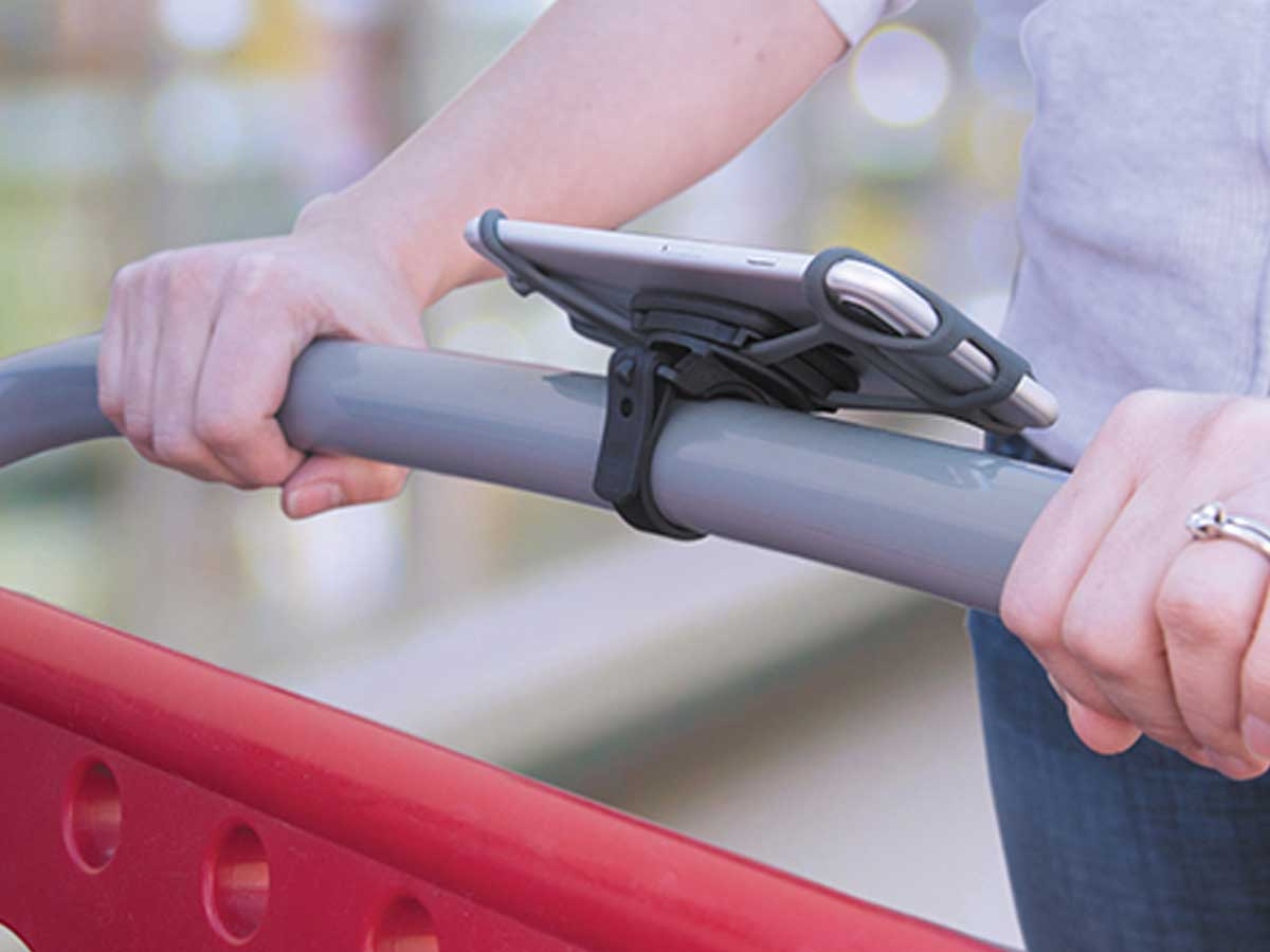 The Nite Ize case on a stroller handle bar