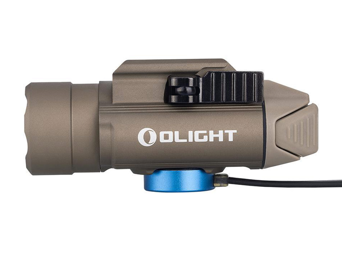 Olight PL PRO tan connected to the charger cable