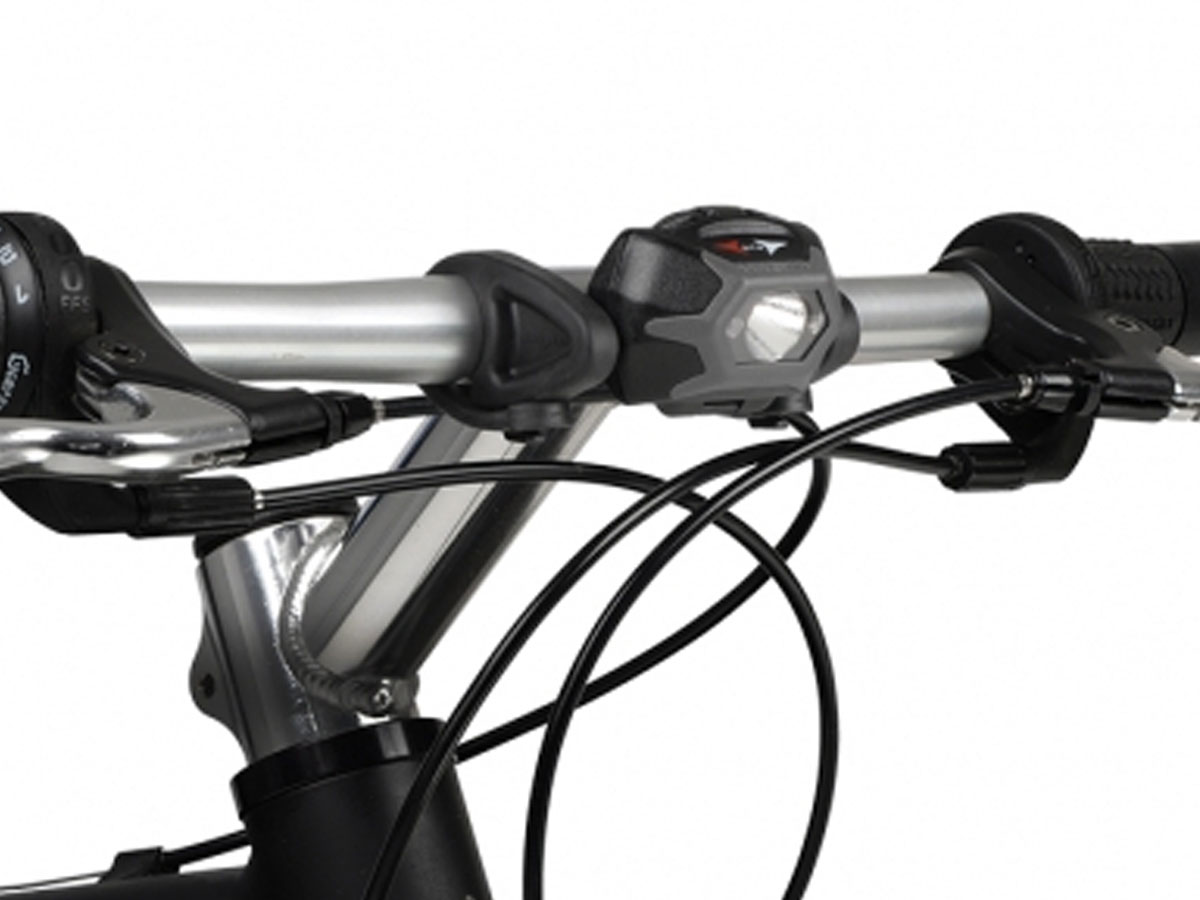 Charcoal Inova STS bike light on handlebars