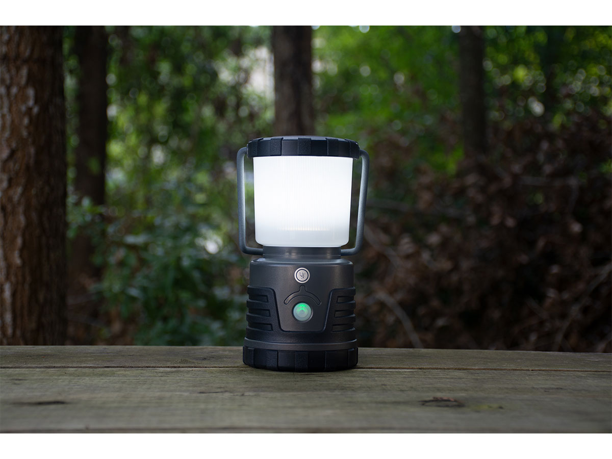 lantern on table in woods