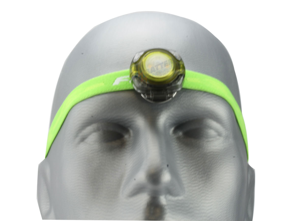 Fenix HL05 headlamp in green on head front view