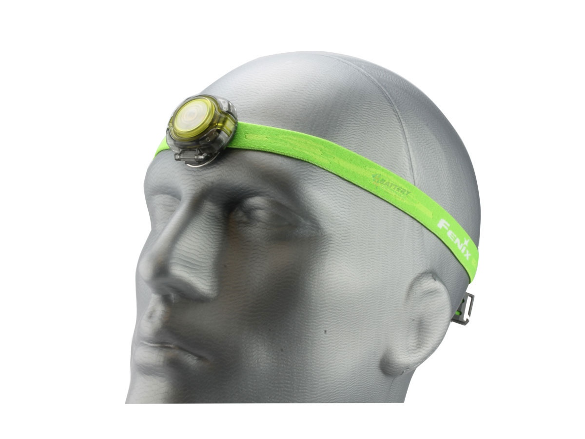 Fenix HL05 headlamp in green on head left side angle