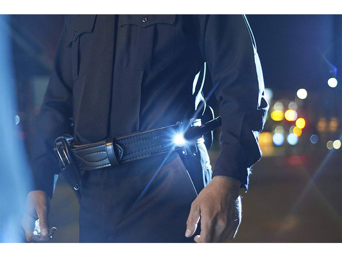 asp tactical holster in use on an officer at night