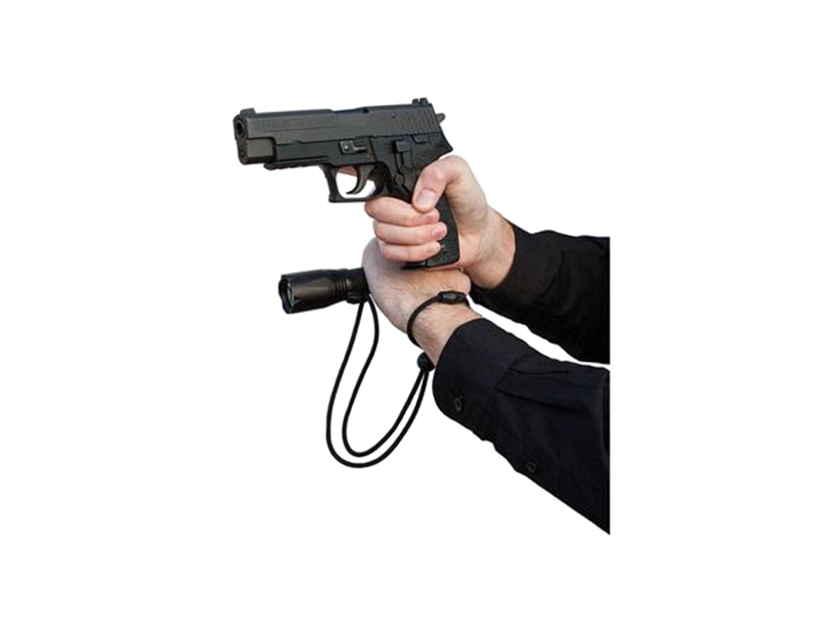 asp light lanyard wrist strap in use with model, flashlight, and tactical handgun