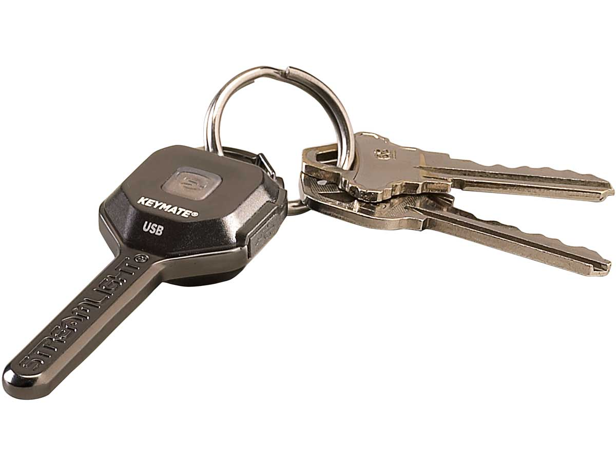 Keychain light attached to a key ring
