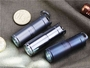 MecArmy X1S LED Flashlight various colors on textured surface