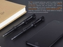 Pen features a strike bezel and black ink