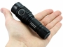 Nitecore MH23 flashlight in hand