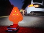 Striker FLEXiT Auto Flexible LED flashlight on road shining on a car and used as traffic cone