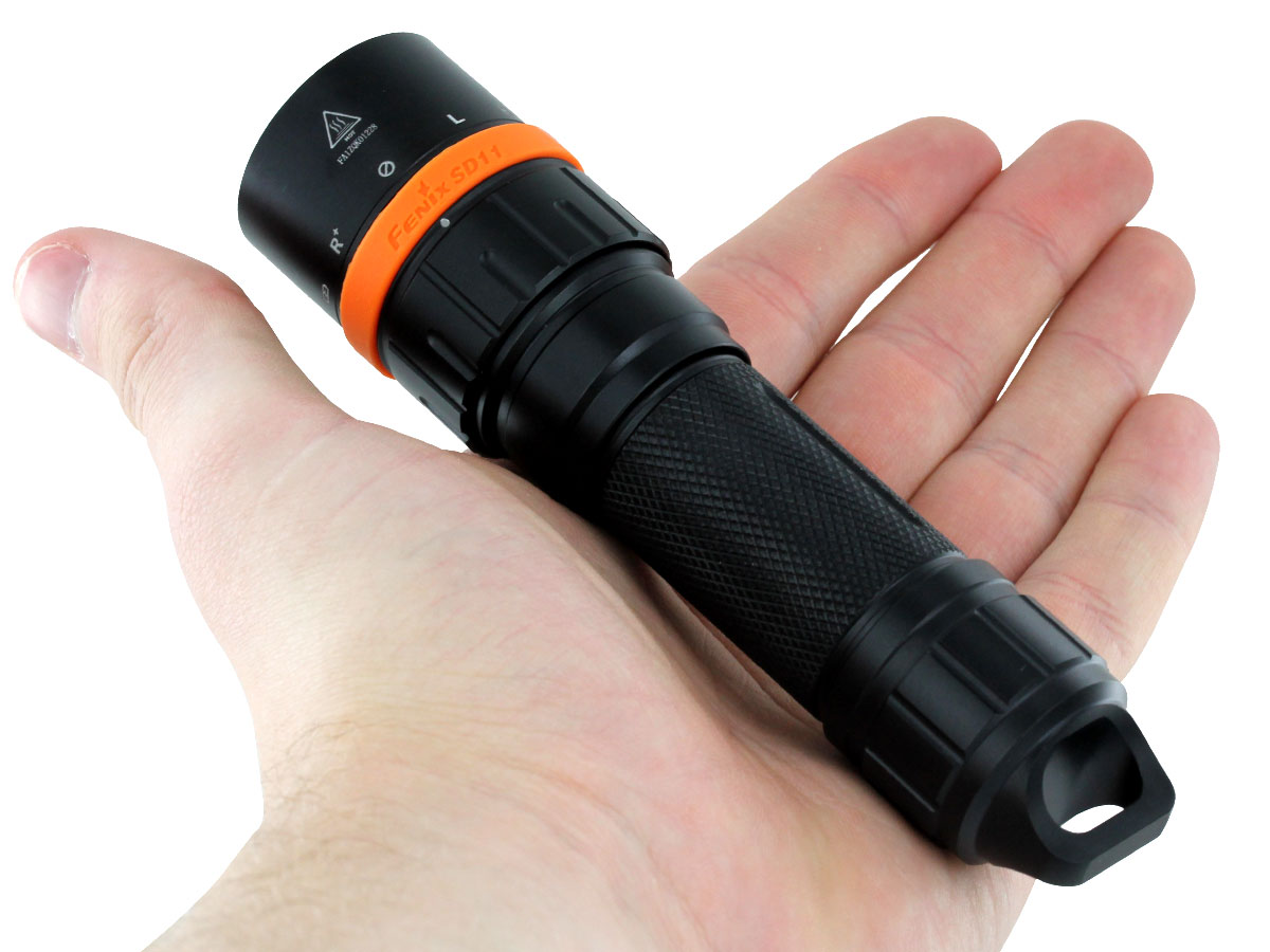 Fenix SD11 flashlight in hand