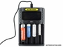 Nitecore UMS4 Charger with batteries inserted - batteries not included just showing how many different sizes can fit at once