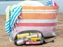 nite ize waterproof toiletry bag in front of beach bag for size comparison