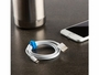 nite ize 3 inch reusable twist tie holding usb cord together with phone and mug in the background