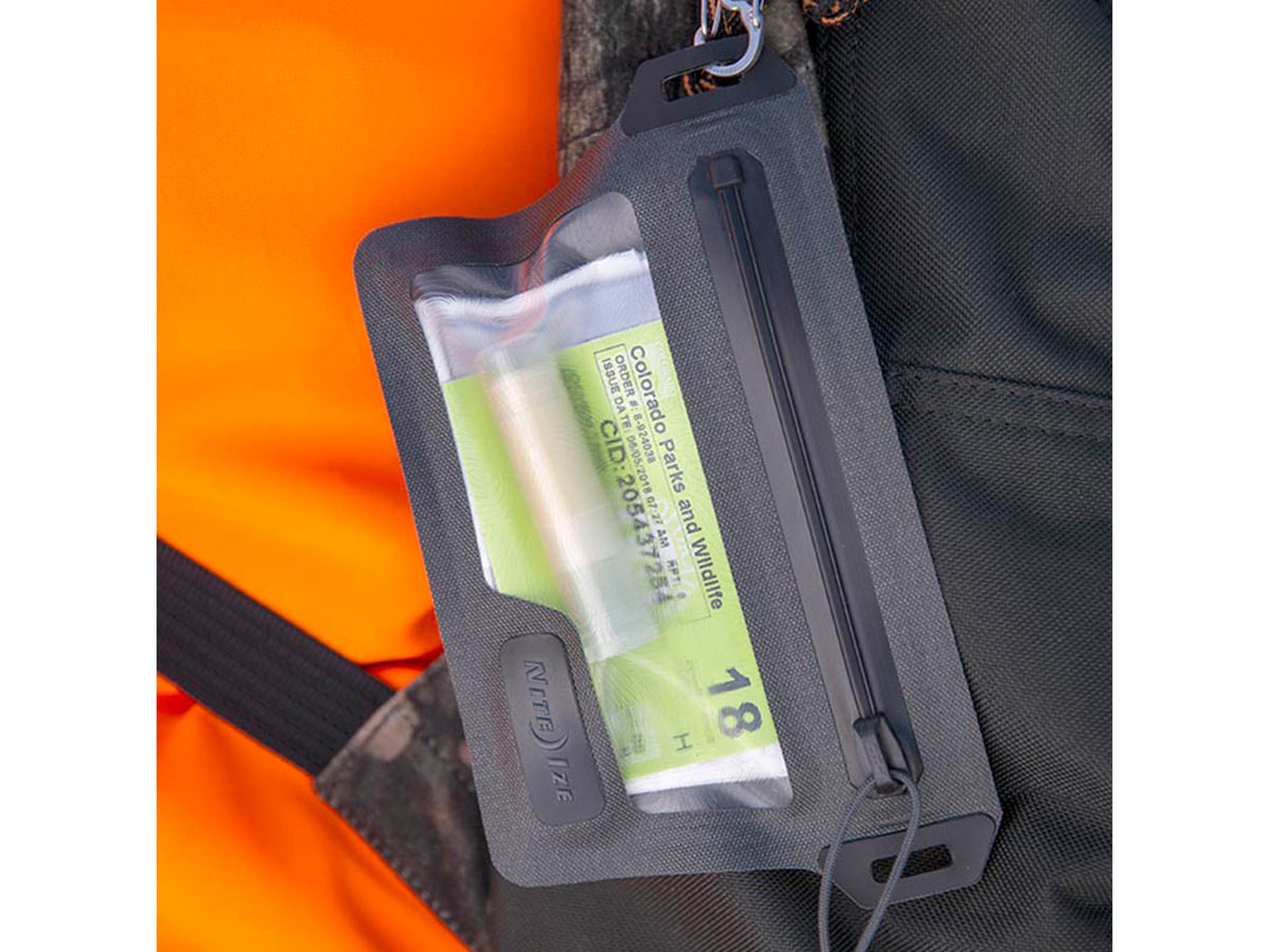 nite ize waterproof wallet being hung from pack