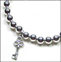 "Sterling Silver 6mm Bead Bracelet with Silver Key (7"" - 7.5"")"