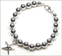 "Sterling Silver 6 mm Bead Bracelet with Starfish Charm (7"" - 7.5"")"