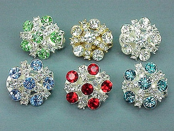 PINWHEEL CRYSTAL CLIP-ON EARRINGS<br>ONE GREEN AND 3 TEAL GREEN LEFT