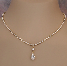IRRESISTIBLE RHINESTONE JEWELRY CLEAR ON GOLD NECKLACE AND EARRINGS SET
