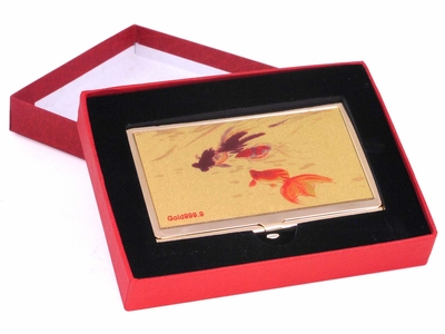 Three Goldfish in Gold Case