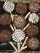 BOX OF 6 CHOCOLATE CARAMEL COVERED OREO COOKIES ON A STICK