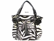 ZEBRA PRINT DRAW STRING TASSELS BAG