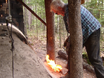 Weber Pulling Hikidashi-Guro (Black Raku) from the Kiln