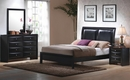 Briana 4-Pc Black Wood/Leatherette Queen Panel Bed Set by Coaster