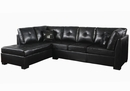 Darie Black Leatherette Reversible Sectional with Ottoman by Coaster