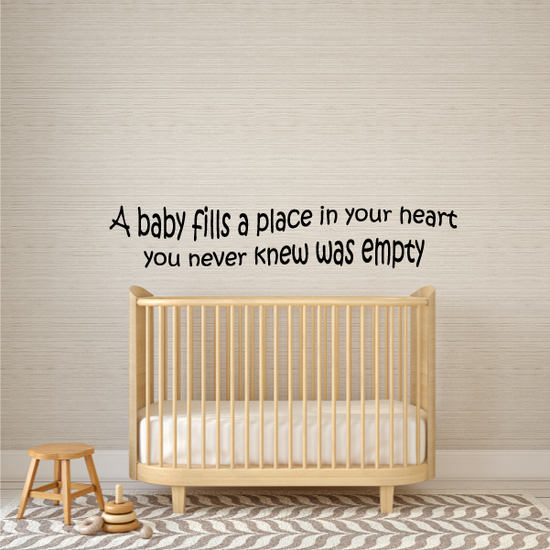A baby fills a place in your heart Wall Decal
