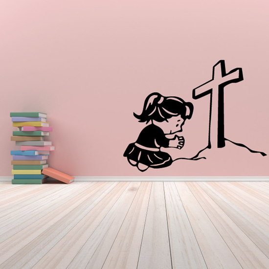 Girl Praying towards cross on a hill Decal