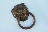 Single brass plated lion head drawer pull <NOBR>(ca. 1920s)</NOBR>