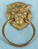 Single cast brass lion head drawer pull, circa 1930s