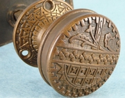 Cast brass doorknob set with backplate and rosette <NOBR>(ca. 1880s)</NOBR>