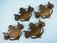 SET of 4 cast & stamped solid brass drawer pulls, circa 1920s