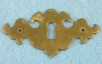 Single large cast brass hand-filed keyhole cover (1084)