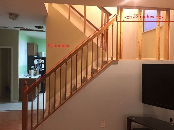Lower staircase railing photo with measurements.