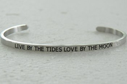 LIVE BY THE TIDES LOVE BY THE MOON