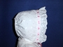 "<img src=""https://p11.secure.hostingprod.com/@grammies-attic.com/ssl/images/blue-sold-1.gif""> White Eyelet Bonnet with Pink Satin Ribbon"