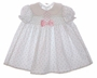 "<img src=""https://p11.secure.hostingprod.com/@grammies-attic.com/ssl/images/blue-sold-1.gif""> Polly Flinders White Flowered Smocked Baby Dress with Pink Satin Bow"