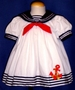 "<img src=""https://p11.secure.hostingprod.com/@grammies-attic.com/ssl/images/blue-sold-1.gif""> White Sailor Dress with Red Anchor Insignia for Baby Girls"