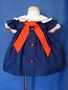 "<img src=""https://p11.secure.hostingprod.com/@grammies-attic.com/ssl/images/blue-sold-1.gif""> Bryan Navy Blue Sailor Dress with Pinafore Style Sleeves for Baby Girls"