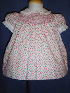 "<img src=""https://p11.secure.hostingprod.com/@grammies-attic.com/ssl/images/blue-sold-1.gif""> Polly Flinders Pink Flowered Smocked Baby Dress"