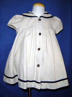 "<img src=""https://p11.secure.hostingprod.com/@grammies-attic.com/ssl/images/blue-sold-1.gif""> Good Lad Natural Linen Sailor Dress with Navy Trim for Baby Girls"
