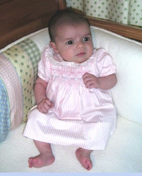 <strong>Baby Ava in Polly Flinders Smocked Dress</strong>