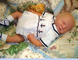 <strong>Baby Doll Daniel in Smocked Sailor Romper</strong>