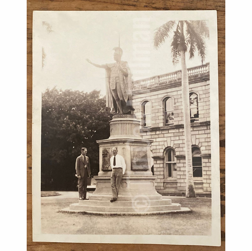 Photograph of men with Kamehameha Statue