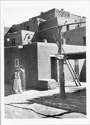 WINNOWING GRAIN, TAOS, NM, c 1929